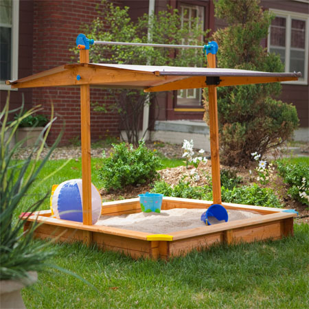 large covered wooden sandbox